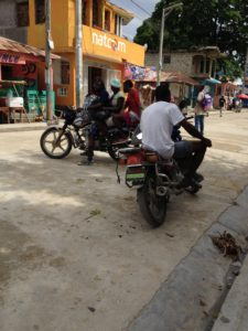 Motor bike taxis provide transport and an income for their drivers