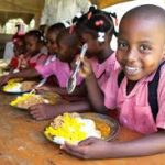 School children enjoying a meal
